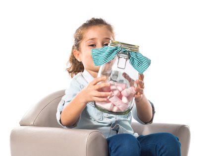 sweetmeats: Blonde girl holding jar glass with sweetmeats inside