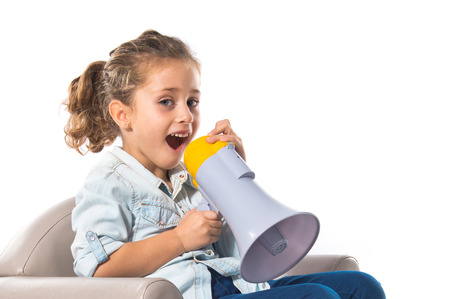 Blonde cute girl shouting by megaphone photo