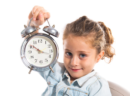 Blonde cute Girl holding a clock photo