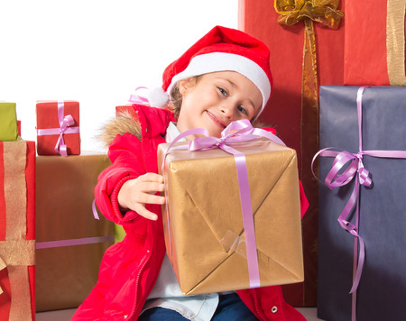 Little girl with several presents