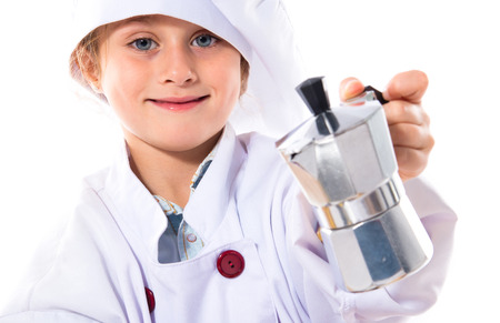 coffee pot: Blonde little girl dressed like chef holding coffee pot Stock Photo