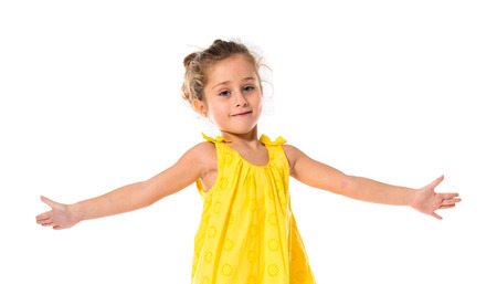 little girl dancing: Blonde little girl dancing over white background Stock Photo