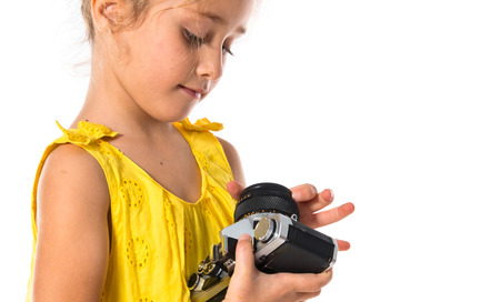 Blonde little girl holding a camera photo
