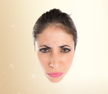 Angry face over isolated white background photo