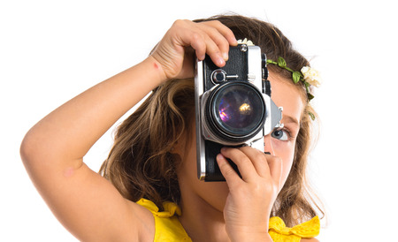Blonde little girl photographing something photo