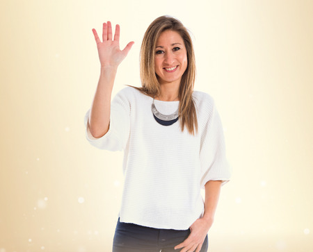Woman saluting over white background