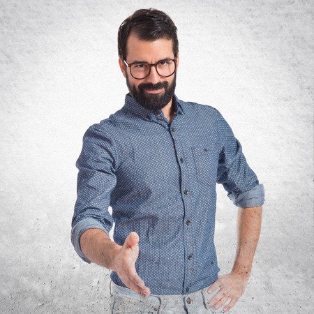 deal making: Young hipster man making a deal