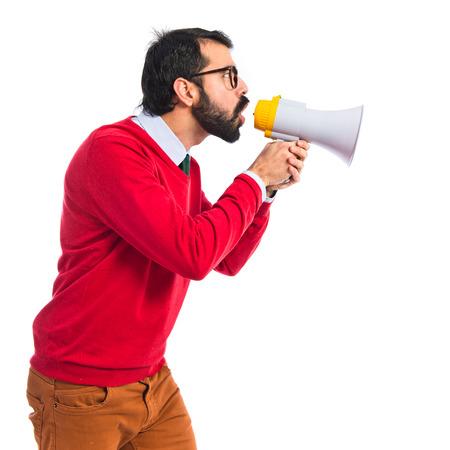 Hipster man shouting by megaphone Standard-Bild
