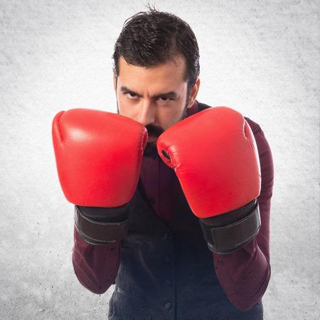 waistcoat: Man wearing waistcoat with boxing gloves
