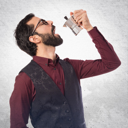 waistcoat: Man wearing waistcoat  holding a coffee pot