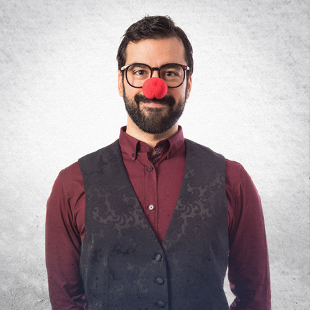 clown nose: Man wearing waistcoat with clown nose