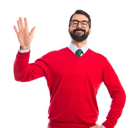 personas saludando: Hombre inconformista saludando sobre fondo blanco Foto de archivo