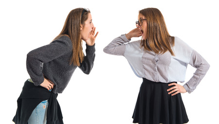 communicatio: One girl shouting and other listening Stock Photo