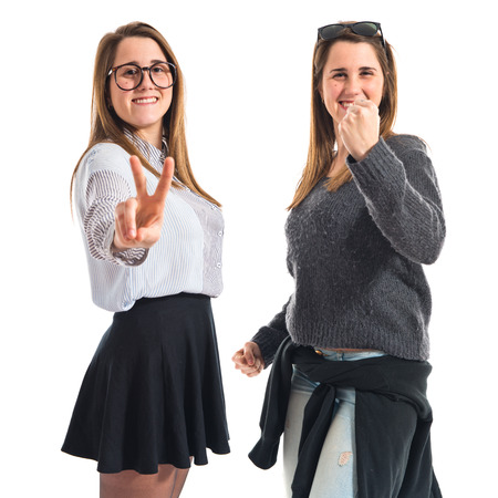 Twin sisters doing victory gesture photo