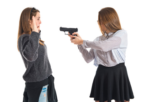 Teen girl pointing with a gun photo