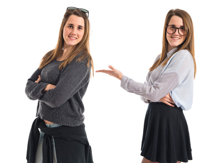 twin sister: Pretty girl presenting her twin sister Stock Photo