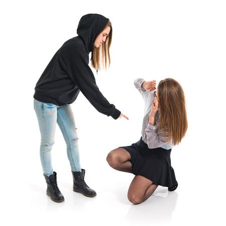 Girl sister shouting her sister photo