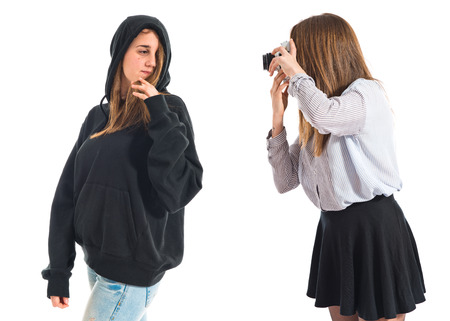 twin sister: Girl photographing at her twin sister