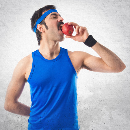 sportman: Sportman eating an apple