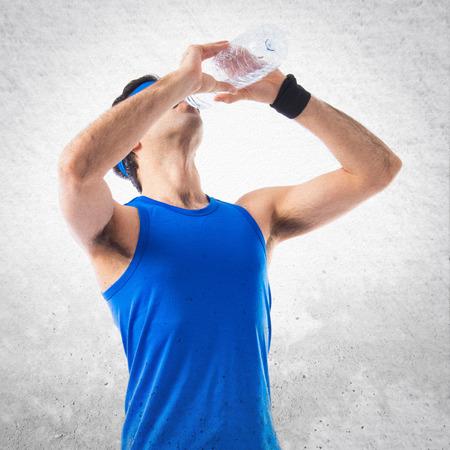 sportman: Sportman drinking water Stock Photo
