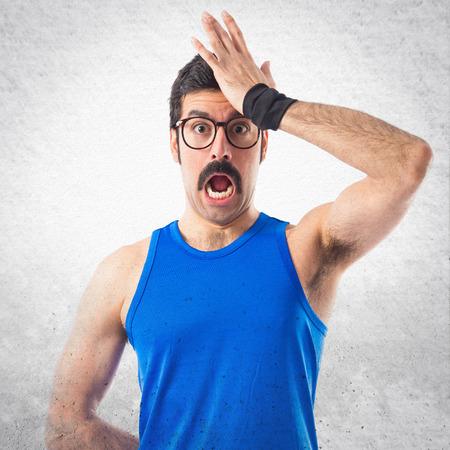 sportman: Crazy sportman doing surprise gesture Stock Photo