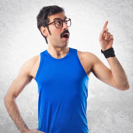 sportman: Crazy sportman thinking over white background