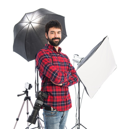 Photographer in his studio with his arms crossed photo