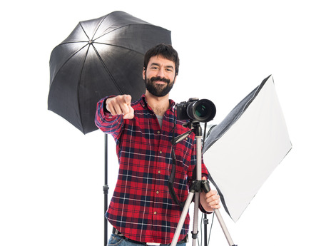 Photographer pointing to the front photo