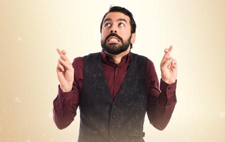 waistcoat: Man wearing waistcoat with his fingers crossing