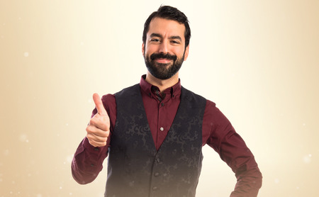 Man wearing waistcoat with thumb up photo
