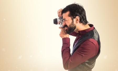 waistcoat: Man wearing waistcoat photographing