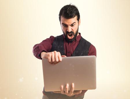 waistcoat: Man wearing waistcoat with laptop Stock Photo