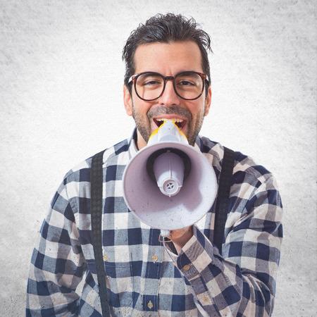 posh: Posh boy shouting by megaphone