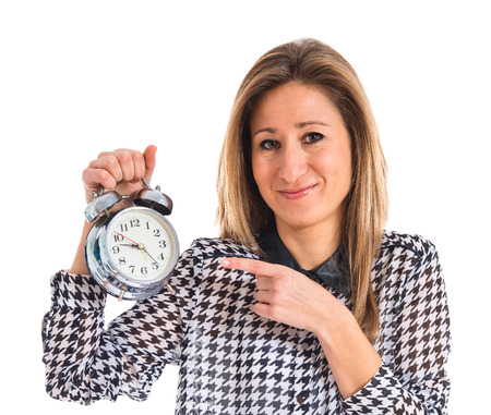 woman with clock: Woman holding vintage clock Stock Photo