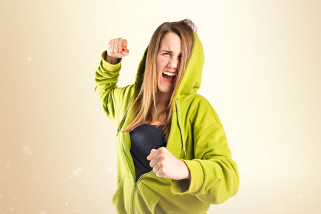 girl punch: Girl giving punch over isolated white background