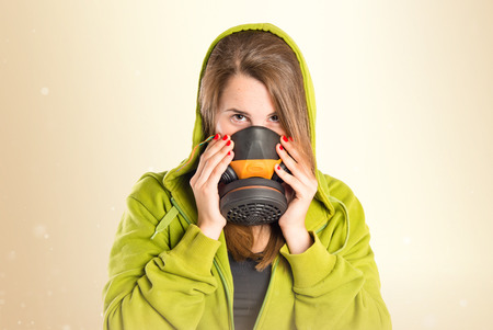 Girl with gas mask over white background Banque d'images