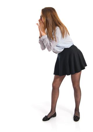 preppy: Girl shouting over white background Stock Photo