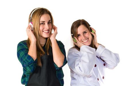 Chefs listening music over white background photo