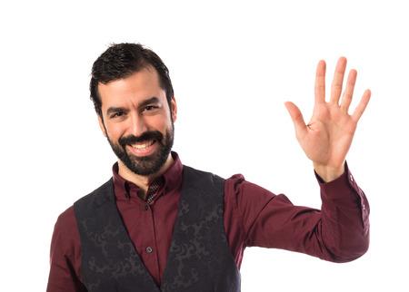 personas saludando: El hombre que llevaba saludando chaleco Foto de archivo