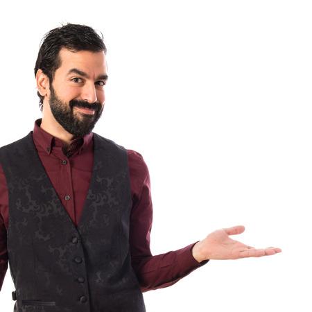 unimportant: Man wearing waistcoat making unimportant gesture Stock Photo