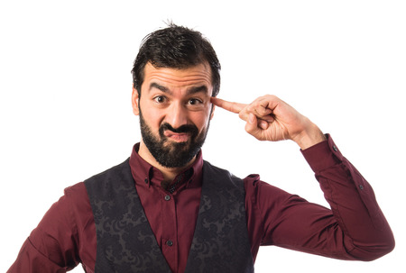 Man wearing waistcoat making crazy gesture