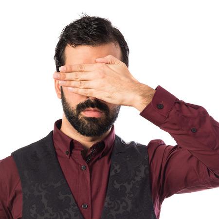 waistcoat: Man wearing waistcoat covering his eyes