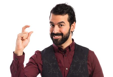 waistcoat: Man wearing waistcoat doing tiny sign Stock Photo