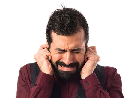 waistcoat: Man wearing waistcoat covering his ears