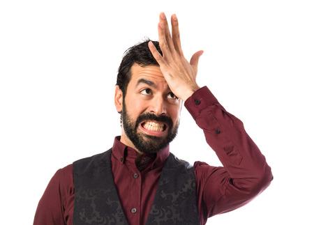 waistcoat: Man wearing waistcoat having doubts Stock Photo