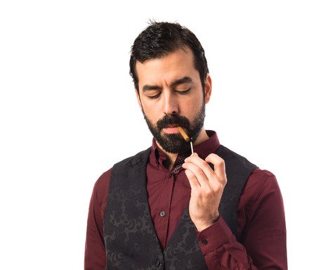 waistcoat: Man wearing waistcoat smoking Stock Photo