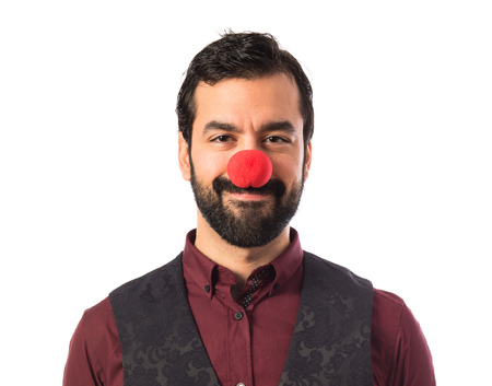 Man wearing waistcoat with clown nose photo