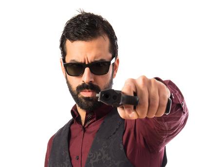 waistcoat: Man wearing waistcoat shooting with a pistol