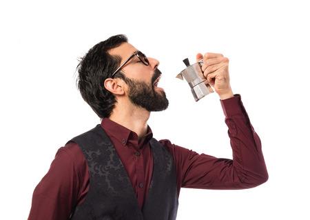 coffee pot: Man wearing waistcoat  holding a coffee pot
