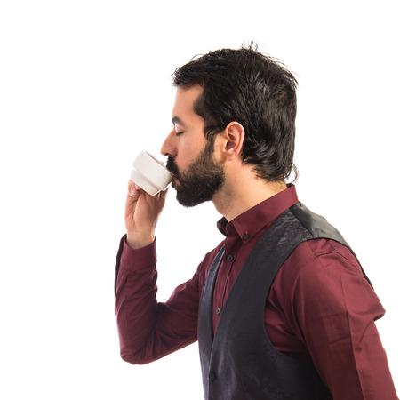 waistcoat: Man wearing waistcoat drinking coffee